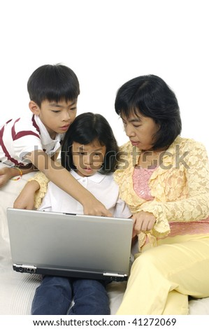 Mother and Daughter,son Using Laptop