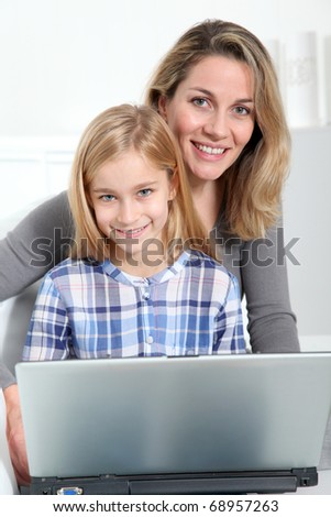 Mother and daughter surfing on internet