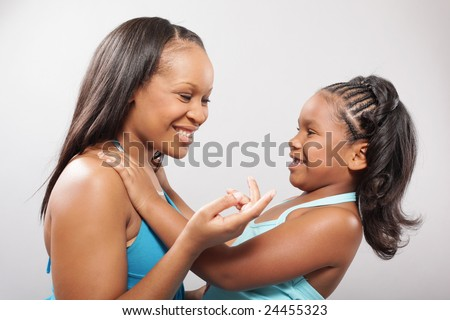 Mother and daughter talking and laughing - stock photo
