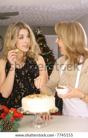 mother and daughter talking over cake