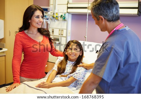 Mother And Daughter Talking To Consultant In Hospital Room - stock photo