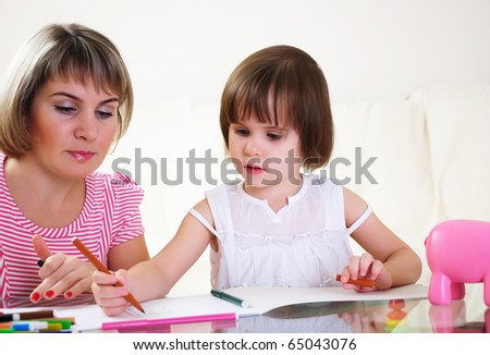 Mother and daughter together paint an album and have fun together.
