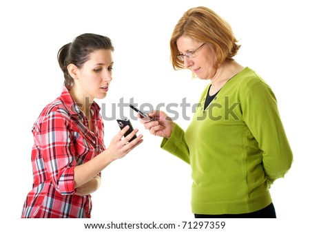 mother and daughter use their mobile phones, daughter shows something on her mobile, isolated on white - stock photo
