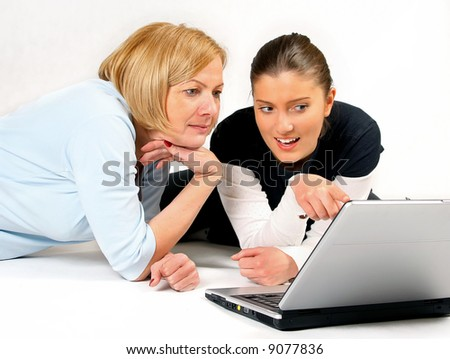 Mother and Daughter Using Laptop over white background - stock photo