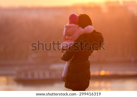 Mother and Daughter walk on a sunny winter day / Mother and Daughter - stock photo