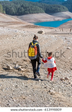 Mother and daughter walking outdoor in the nature