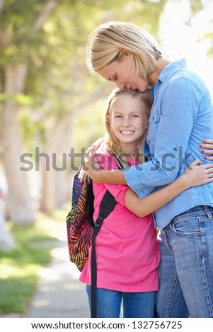 Mother And Daughter Walking To School On Suburban Street - stock photo