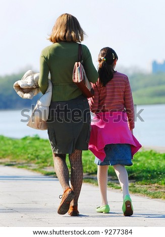 Mother and daughter walking together