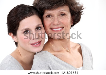 Mother and daughter wearing matching clothes - stock photo