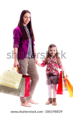 mother and daughter with   bags, isolated on white background - stock photo