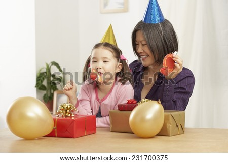 Mother and Daughter With Birthday Presents - stock photo