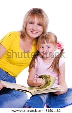 Mother and daughter with book - stock photo