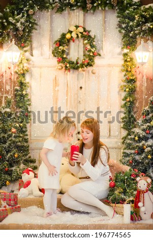 Mother and daughter with candle - stock photo