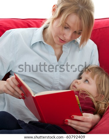 mother and daughter with curiosity reading book - stock photo