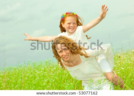 Mother and daughter with flower. Focus on eyes