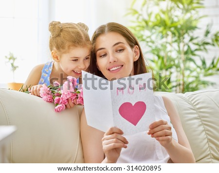 mother and daughter with flowers - stock photo