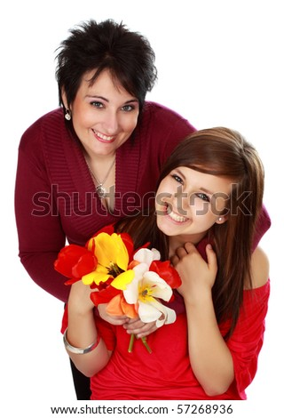 mother and daughter with flowers, white background - stock photo