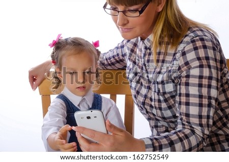 mother and daughter with mobile phone