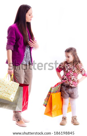 mother and daughter with shopping bags  - stock photo