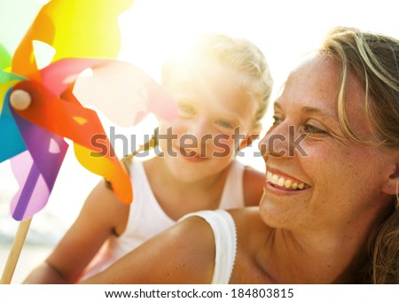 Mother and Daughter With Windmill - stock photo