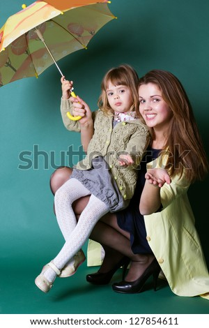 Mother and daughter with yellow umbrella