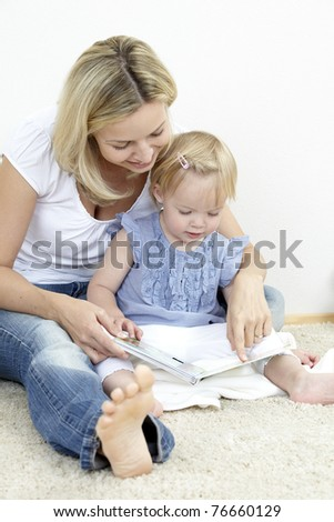 mother and daughterreading a book