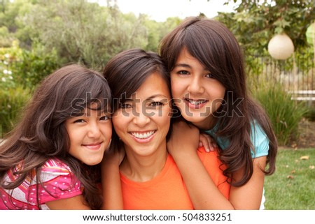 Mother and daughters. Happy family.
