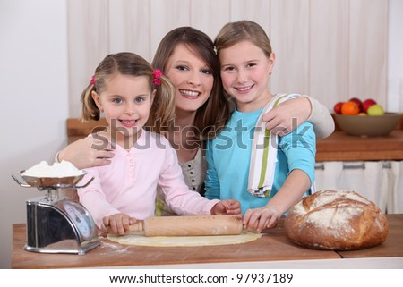 Mother and daughters making bread