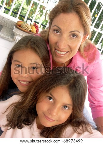 Mother and daughters portrait. - stock photo
