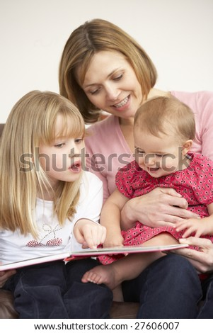 Mother And Daughters Reading Book - stock photo