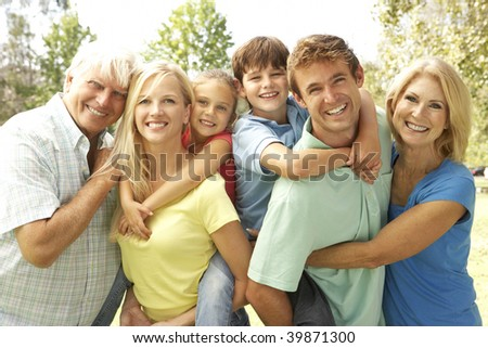 Mother And Father Giving Children Piggy Back With Grandparents - stock photo