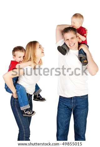 Mother and father riding two young children piggyback - stock photo