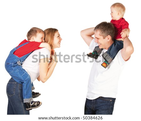 Mother and father riding two young children piggyback