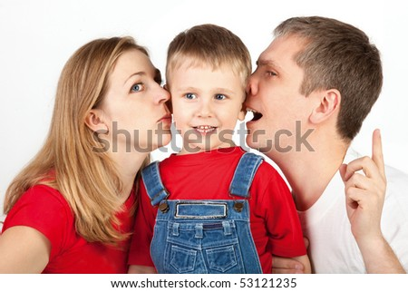 Mother and father whisper in son's ears