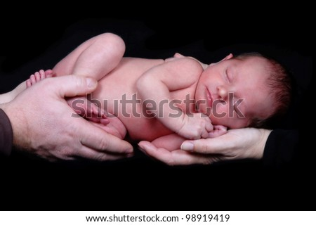 Mother and Father with Newborn - stock photo