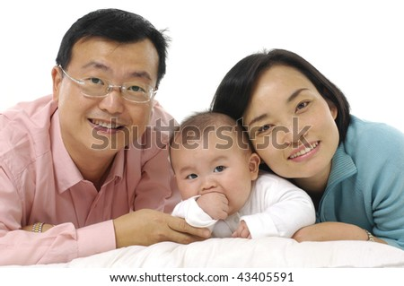 Mother and father with young son at home - stock photo