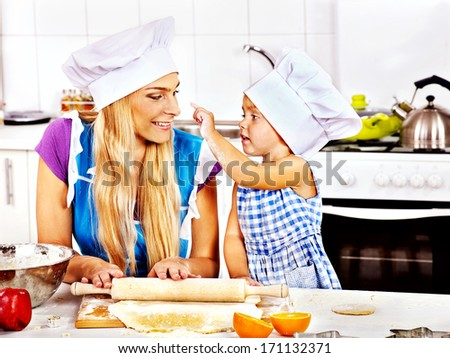 Mother and granddaughter baking cookies. - stock photo