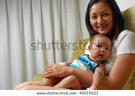 mother and happy baby - stock photo