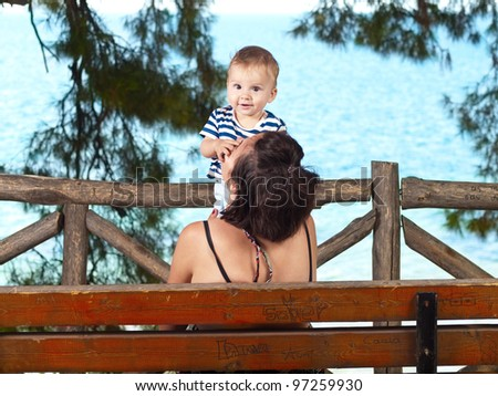 Mother and her baby boy enjoying summer - stock photo