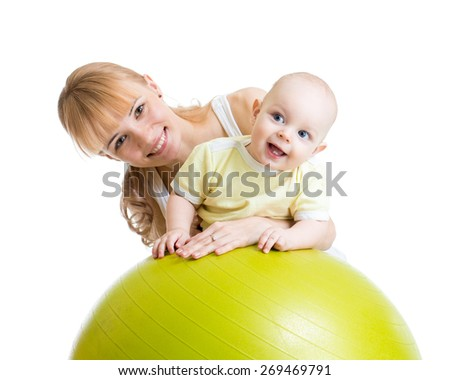 mother and her baby boy having fun with gymnastic ball  - stock photo