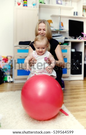 mother and her baby having fun playing at home