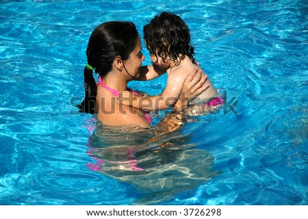 mother and her baby in the swimmingpool