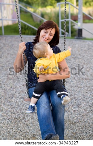 Mother and her baby on the playground - stock photo