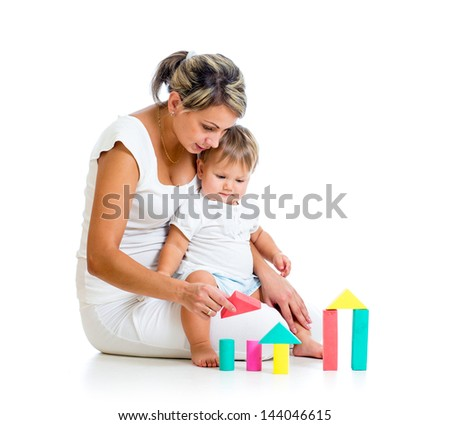 mother and her baby playing building blocks toy - stock photo