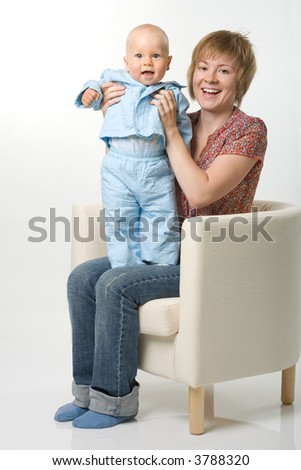 Mother and her baby sitting on chair