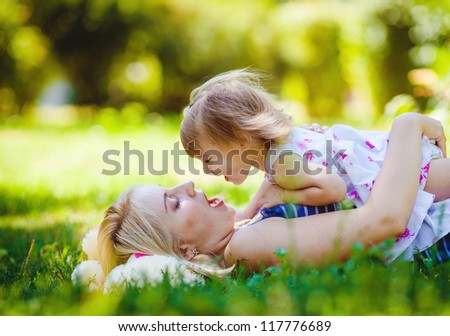 Mother and her child enjoy the summer in green park outdoor