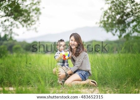 Mother and her child enjoy the summer in green park outdoor.