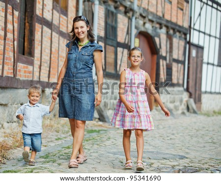 Mother and her child outdoors in city - stock photo