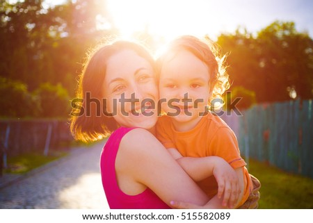 mother and her child played in the street, happy family
