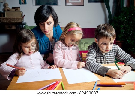 Mother and her children drawing - stock photo